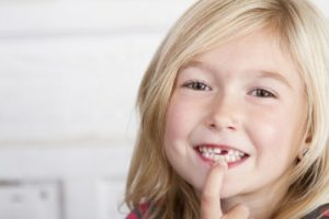 little girl with missing tooth