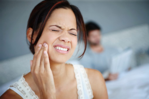 woman with face pain